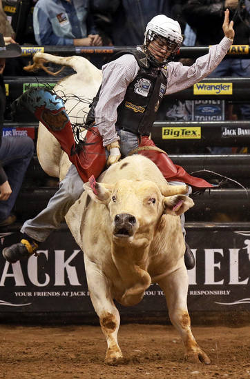 Lachlan Richardson competes atop Ballistic during the WinStar World Casino Invitational PBR bull riding event at Chesapeake Energy Arena in Oklahoma City, Friday, Jan. 25, 2013. Photo by Nate Billings, The Oklahoman