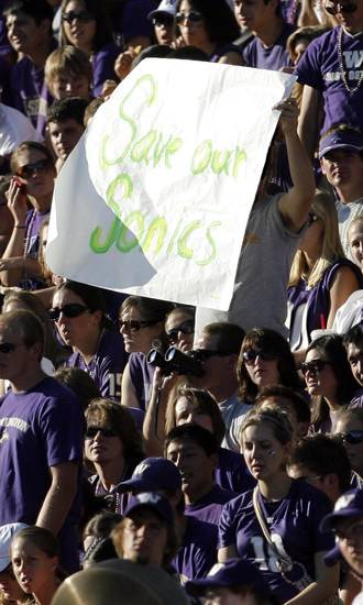 "A UW fan holds a sign that reads ""Save Our Sonics ""in the first half during the college football game between Oklahoma and Washington at Husky Stadium in Seattle, Wash., Saturday, September 13, 2008. BY NATE BILLINGS, THE OKLAHOMAN"