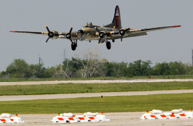 A Boeing B-17 Flying Fortress lands at Wiley Post Airport as part of the Wings of Freedom Tour in Bethany, Okla., Friday, April 6, 2012. The Wings of Freedom Tour travels the country with vintage World War II aircraft to show the public as a living history display. Photo by Nate Billings, The Oklahoman