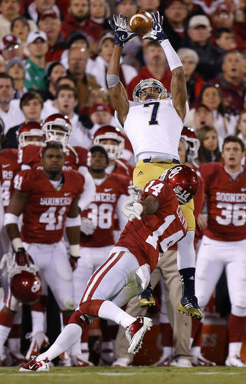Notre Dame's TJ Jones (7) catches a pass over OU's Aaron Colvin (14) during the college football game between the University of Oklahoma Sooners (OU) and the Notre Dame Fighting Irish at Gaylord Family-Oklahoma Memorial Stadium in Norman, Okla., Saturday, Oct. 27, 2012. Oklahoma lost 30-13. Photo by Bryan Terry, The Oklahoman