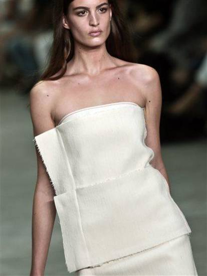 Fashion from the Calvin Klein Spring 2014 collection is modeled on Thursday, Sept. 12, 2013 in New York.  (AP Photo/Bebeto Matthews)