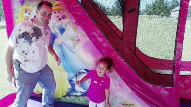 This undated file photo provided by Amanda Clinton of the Cherokee Nation shows four-year-old Veronica, right, with her biological father, Dusten Brown, at a birthday party for her in Tahlequah, Okla. (AP Photo/Cherokee Nation, Amanda Clinton, File)