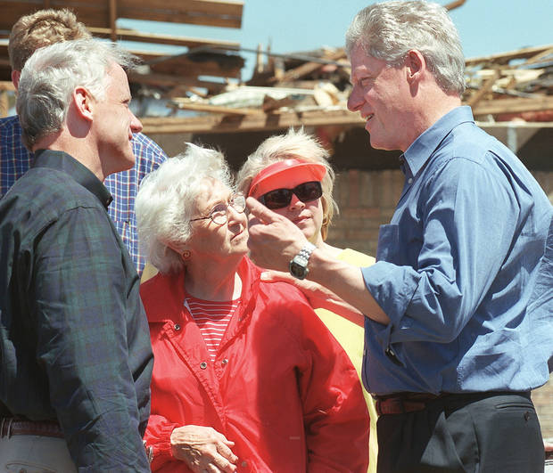 Tornado damage tour: President Bill Clinton and Gov. Frank Keating talk with Jo Goodsdpeed