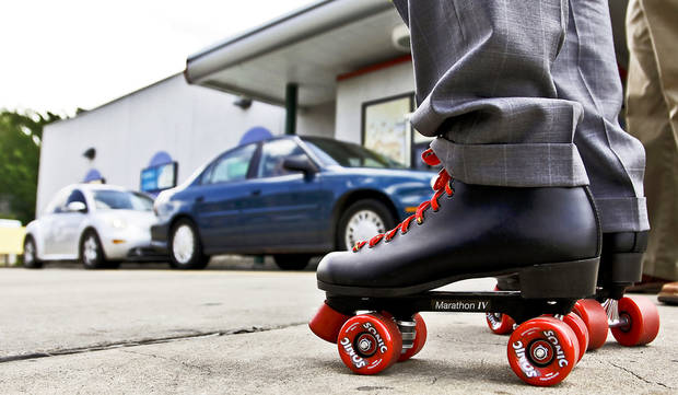 "Sonic's senior director of brand marketing Matt Schein wears a pair of skates during a filming of the new show ""Fast Food Mania."" <strong>CHRIS LANDSBERGER - CHRIS LANDSBERGER</strong>"