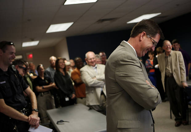 Norman police Capt. Darry Stacy reacts as people tell stories about his career at a retirement reception in his honor Friday. PHOTO BY GARETT FISBECK, THE OKLAHOMAN <strong>GARETT FISBECK</strong>