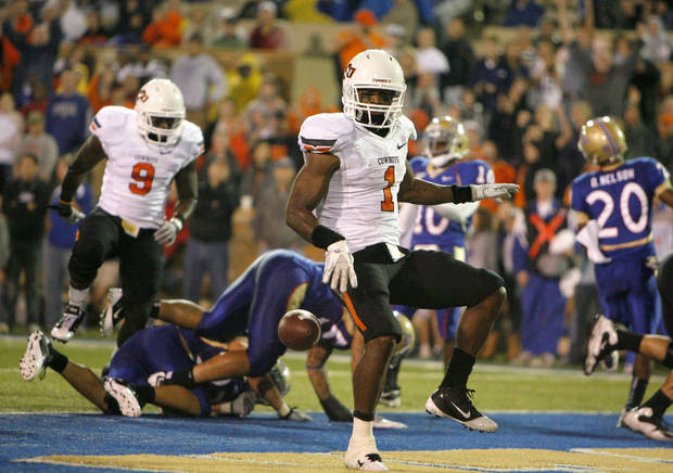 Oklahoma State's' Joseph Randle (1) celebrates a touchdown during a college football game between the Oklahoma State University Cowboys and the University of Tulsa Golden Hurricane at H.A. Chapman Stadium in Tulsa, Okla., Sunday, Sept. 18, 2011. Photo by Sarah Phipps, The Oklahoman