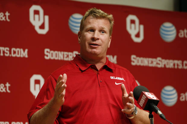 Associate head coach Mike Stoops addresses the media during media access day for the University of Oklahoma Sooner (OU) football team in the Adrian Peterson meeting room inside Gaylord Family-Oklahoma Memorial Stadium in Norman, Okla., on Saturday, Aug. 3, 2013. Photo by Steve Sisney, The Oklahoman