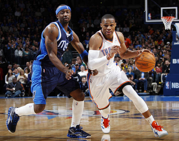 Oklahoma City's Russell Westbrook (0) drives the ball past Jason Terry (31) of Dallas in the first half of an NBA basketball game between the Oklahoma City Thunder and the Dallas Mavericks at Chesapeake Energy Arena in Oklahoma City, Thursday, Dec. 29, 2011. Photo by Nate Billings, The Oklahoman