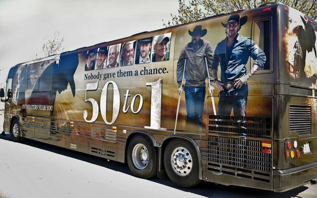 """Director, producer, co-writer Jim Wilson, actor Jamie McShane and co-writer Faith Conroy for the movie """"50 to 1"""" pose for a photo in Oklahoma City, Okla. on Tuesday, April 8, 2014. The trio is on a bus tour to promote the April 11 Oklahoma opening of the movie. Photo by Chris Landsberger, The Oklahoman"""