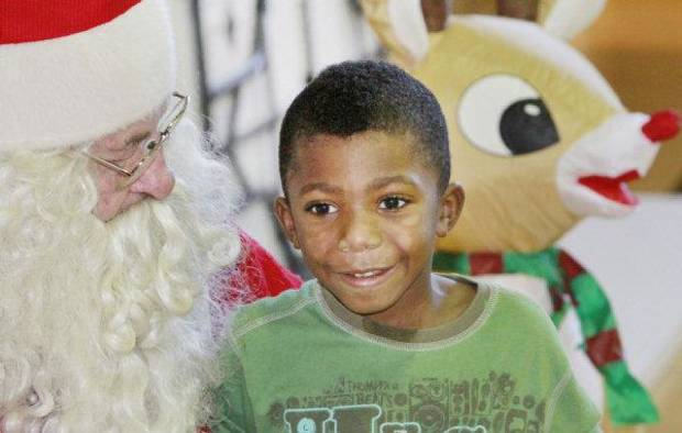 Josepher Powell, 4, sits on Santa&acirc;s lap.