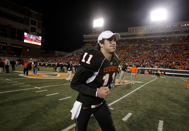 OSU's Zac Robinson (11) runs off the field following the college football game between Oklahoma State University (OSU) and the University of Colorado (CU) at Boone Pickens Stadium in Stillwater, Okla., Thursday, Nov. 19, 2009. Photo by Sarah Phipps, The Oklahoman
