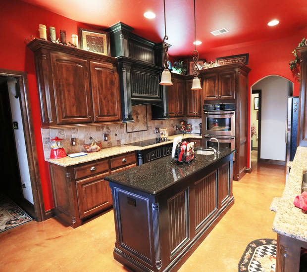 Dark cabinetry complements the rich red coloring of the Gooch kitchen at 13217 SE 94.