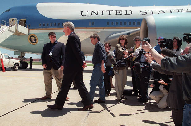 President Bill Clinton prepares to board Air Force One after speaking to the press about NATO's bombing of the Chinese Embassy in Belgrade.