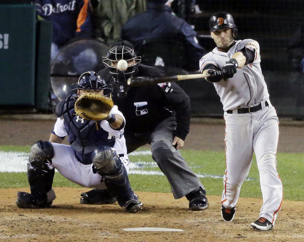 FILE - In this Oct. 28, 2012, file photo, San Francisco Giants' Marco Scutaro hits an RBI single during the 10th inning of Game 4 of baseball's World Series against the Detroit Tigers in Detroit. Two people with knowledge of the negotiations said Tuesday, Dec. 4, that Scutaro is weighing a two-year contract offer from the Giants that includes a vesting option. (AP Photo/Charlie Riedel, File)