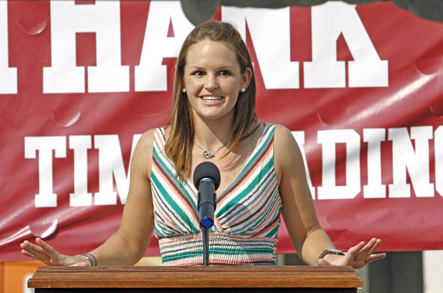 Whitney Hand speaks for student athletes as she participates in a 2011 beam raising/groundbreaking ceremony with major donor Tim Headington at a new student housing center at OU. PHOTO BY STEVE SISNEY, The Oklahoman Archives