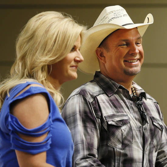 Trisha Yearwood and Garth Brooks talk to the media during the Oklahoma Twister Relief Concert, benefiting victims of the May tornadoes, at Gaylord Family - Oklahoma Memorial Stadium on the campus of the University of Oklahoma in Norman, Okla., Saturday, July 6, 2013. Photo by Nate Billings, The Oklahoman