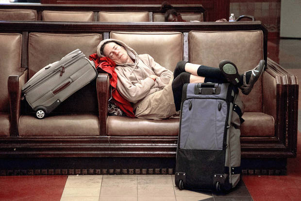 A traveler sleeps Wednesday at Union Station in Los Angeles.  AP Photo