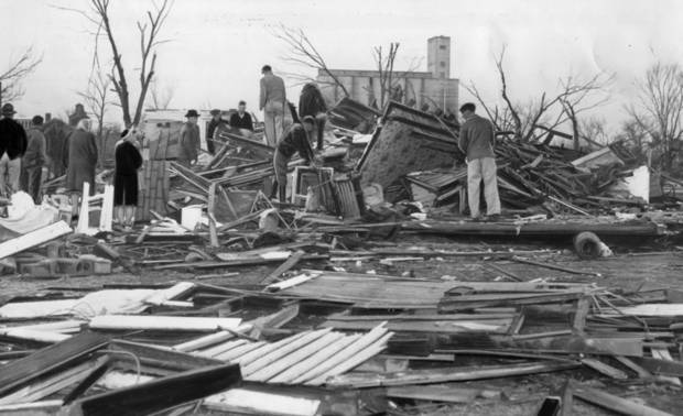 The search for dead and injured began immediately after Wednesday night's tornado and still was  continuing Thursday at Woodward.  This is a typical scene all over the city as workers pulled wreckage away in their tragic search.   4/10/1947