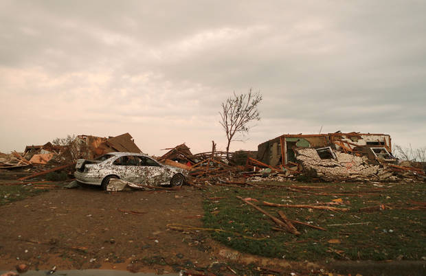 Damage to a home near Plaza Towers Elementary School in Moore, Okla., after a tornado moved through the area on Monday, May 20, 2013. Photo by Bryan Terry, The Oklahoman
