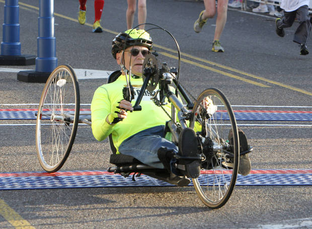 Ada resident Ken Lewis crosses the finish line of the half-marathon in a wheelchair during the Oklahoma City Memorial Marathon in Oklahoma City, Sunday, April 28, 2013,  By Paul Hellstern, The Oklahoman