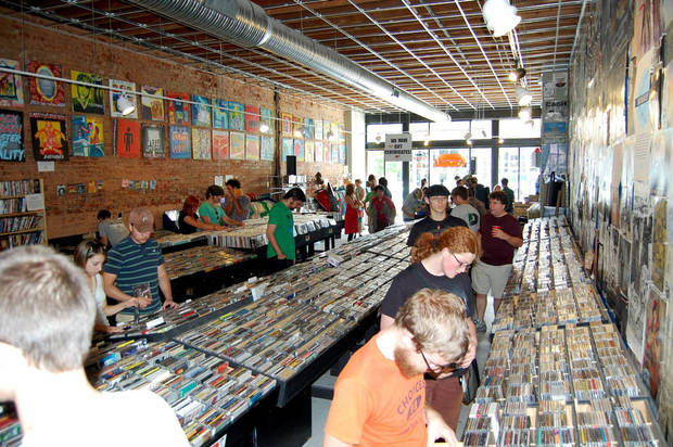 Customers browse through recordings at Guestroom Records in Norman. Photo by Will Muir for The Oklahoman