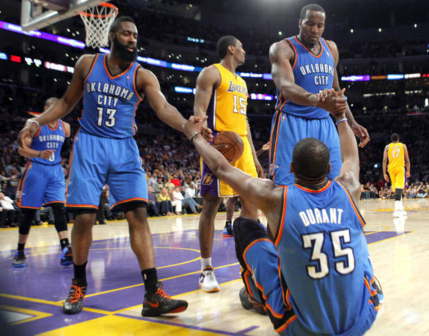 Oklahoma City's James Harden (13), Kendrick Perkins (5) help up Oklahoma City's Kevin Durant (35) during Game 4 in the second round of the NBA basketball playoffs between the L.A. Lakers and the Oklahoma City Thunder at the Staples Center in Los Angeles, Saturday, May 19, 2012. Photo by Nate Billings, The Oklahoman