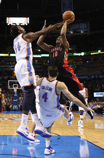 Oklahoma City's Hasheem Thabeet (34) and Nick Collison (4) defend Toronto's DeMar DeRozan (10) during an NBA basketball game between the Oklahoma City Thunder and the Toronto Raptors at Chesapeake Energy Arena in Oklahoma City, Tuesday, Nov. 6, 2012.  Tuesday, Nov. 6, 2012. Oklahoma City won 108-88. Photo by Bryan Terry, The Oklahoman