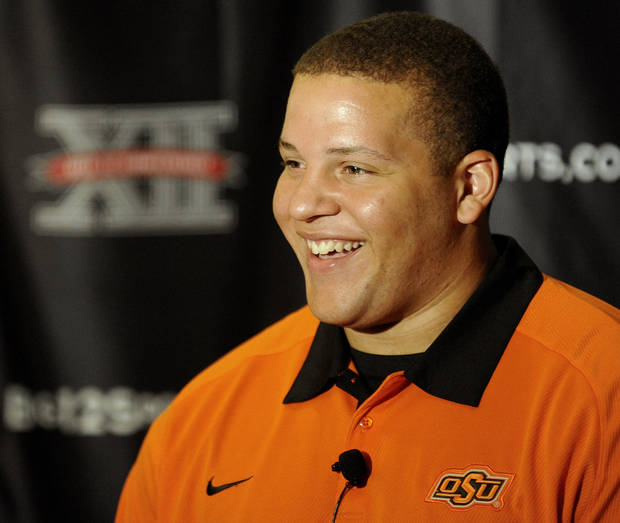 Oklahoma State offensive lineman Lane Taylor smiles during the Big 12 Conference NCAA college football media days, Tuesday, July 24, 2012, in Dallas. (AP Photo/Matt Strasen) ORG XMIT: TXMS114