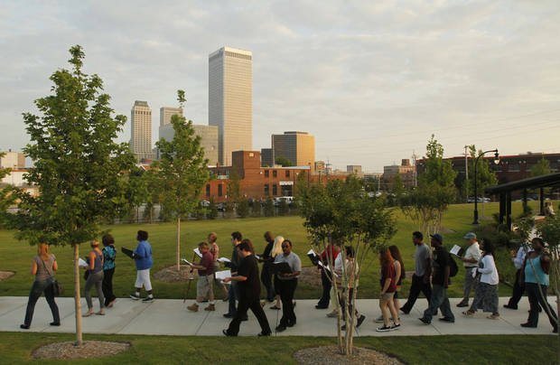 In this file photo from last May, participants begin a walk in observance of the 1921 Tulsa Race Riot in John Hope Franklin Reconciliation Park in Tulsa. PHOTO BY JAMES GIBBARD/TULSA WORLD.  <strong>JAMES GIBBARD</strong>