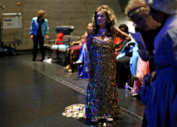 Contestant Tamara Taylor-Jones of Ada waits in her evening gown backstage during the Ms. Oklahoma Senior America Pageant. Photo by Bryan Terry, The Oklahoman