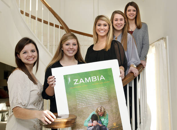 Casady High students, from left, Madison Utz, Emily Ellis, Maya Shiff, Laura Joulian and Abigail Utz started a charity after a visit to Zambia. The girls, seen here in a 2011 photo, will be honored with the student Dignity Award from World Neighbors. <strong>SARAH PHIPPS - The Oklahoman</strong>