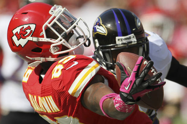 Kansas City Chiefs wide receiver Jon Baldwin (89) tries to catch a pass while covered by Baltimore Ravens defensive back Jimmy Smith during the second half of an NFL football game at Arrowhead Stadium in Kansas City, Mo., Sunday, Oct. 7, 2012. (AP Photo/Colin E. Braley)