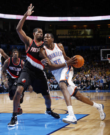 Oklahoma City's Kevin Durant (35) drives to the basket as Kurt Thomas (40) defends for Portland in the first half during the NBA basketball game between the Oklahoma City Thunder and Portland Trail Blazers at Chesapeake Energy Arena in Oklahoma City, Tuesday, Jan. 3, 2012. Photo by Nate Billings, The Oklahoman