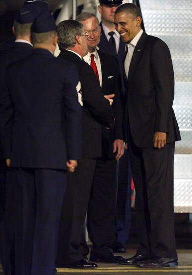 President Barack Obama greets Oklahoma City Mayor Mick Cornett as he exits Air Force One at Tinker Air Force Base in Midwest City, Wednesday, March 21, 2012. President Obama is in town for a visit to Cushing, Okla., on Thursday. Photo by Bryan Terry, The Oklahoman