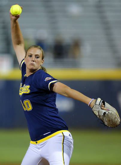 Michigan's Sara Driesenga pitches against Arizona State during their Women's College World Series softball game at ASA Hall of Fame Stadium in Oklahoma City, Sunday, June, 2, 2013. Photo by Bryan Terry, The Oklahoman