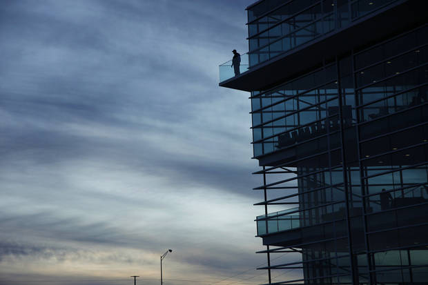 A man stands on the top balcony of the Chesapeake Finish Line Tower at the Oklahoma River Friday, November 11, 2011. Photo by Doug Hoke, The Oklahoman