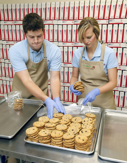Mac and Heather Carver prepare packages of cookies at Cookie Advantage in Edmond. <strong>PAUL HELLSTERN - The Oklahoman</strong>