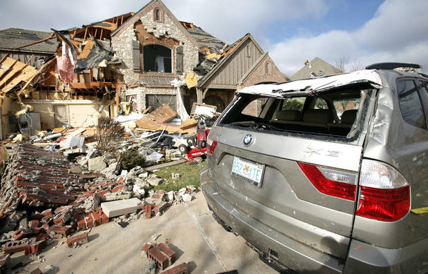 This home in the Oak Tree housing addition in  Edmond was damaged by a tornado.  PHOTO BY CHRIS LANDSBERGER, THE OKLAHOMAN