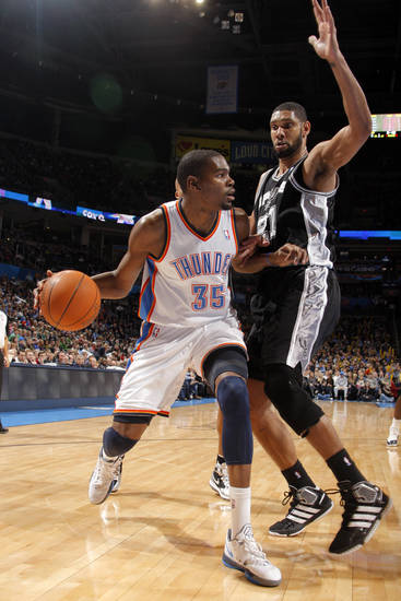 Oklahoma City Thunder's Kevin Durant (35) tries to get around San Antonio Spurs' Tim Duncan (21) during the the NBA basketball game between the Oklahoma City Thunder and the San Antonio Spurs at the Chesapeake Energy Arena in Oklahoma City, Sunday, Jan. 8, 2012. Photo by Sarah Phipps, The Oklahoman