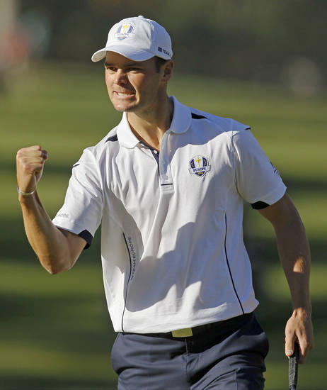 Europe's Martin Kaymer reacts after making a putt on the 14th hole during a singles match at the Ryder Cup PGA golf tournament Sunday, Sept. 30, 2012, at the Medinah Country Club in Medinah, Ill. (AP Photo/Charles Rex Arbogast)  ORG XMIT: PGA181