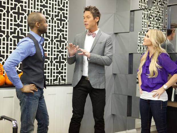 Mentor David Bromstad, center, talks with designers Mikel Welch and Britany Simon on HGTV�s �Design Star All Stars.� HGTV photo