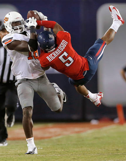Oklahoma State&#039;s Blake Jackson (18)  makes a catch as Arizona&#039;s Shaquille Richardson (5) defends during the college football game between the University  of Arizona and Oklahoma State University at Arizona Stadium in Tucson, Ariz.,  Sunday, Sept. 9, 2012. Photo by Sarah Phipps, The Oklahoman