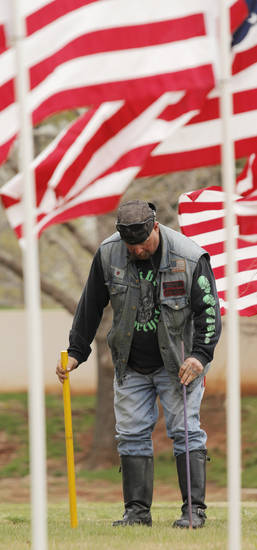 """Sick"" Boyd, with Bikers Against Child Abuse, helps to plant posts for American flags in honor of children who died in America in 2011 in the fields south of the state Capitol Sunday, April 7, 2013. Photo by Doug Hoke, The Oklahoman"