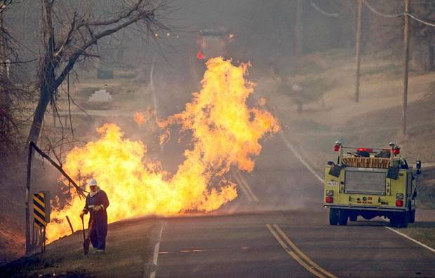 SECOND PLACE, ARPIL: Flames leap out of a broken gas line in Midwest City, Okla., Thursday, April 9, 2009. Fire crews in Oklahoma and Texas raced Thursday to control wind-whipped wildfires that destroyed dozens of homes, forced evacuations and shut down parts of a major highway. Photo by Bryan Terry, The Oklahoman