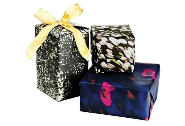 This product image released by One Kings Lane shows gift-wrapped boxes with paper designed by stylist-designer Rachel Zoe. Zoe is among the tastemakers that partnered with the site for the One Kings Lane Holiday Charity Series. (AP Photo/One Kings Lane) <strong> - AP</strong>