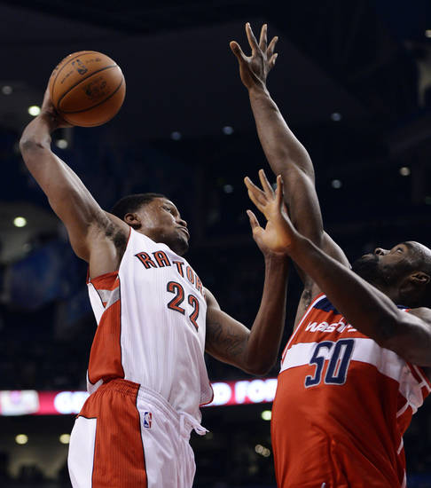 Washington Wizards' Emeka Okafor (50) defends against Toronto Raptors' Rudy Gay during the first half of their NBA basketball game, Monday, Feb. 25, 2013, in Toronto. (AP Photo/The Canadian Press, Frank Gunn)