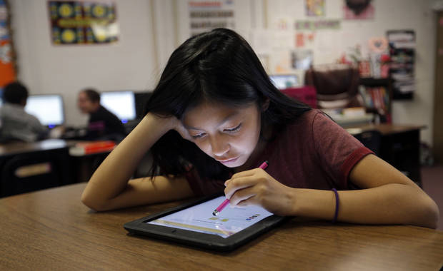 Aliyah Harjochee works on an iPad at Ryal Public School, Wednesday, Feb. 13, 2013. Photo by Sarah Phipps, The Oklahoman