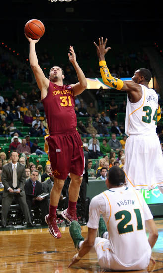 Iowa State's Georges Niang (31) shoots past Baylor's Cory Jefferson (34) and Isaiah Austin (21) in the first half of an NCAA college basketball game, Wednesday, Feb. 20, 2013, in Waco, Texas. (AP Photo/The Waco Tribune-Herald, Michael Bancale)