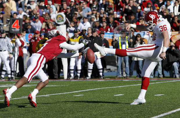 Richard Sherman blocks a punt attempt by Tress Way during the first half of the Brut Sun Bowl college football game between the University of Oklahoma Sooners (OU) and the Stanford University Cardinal on Thursday, Dec. 31, 2009, in El Paso, Tex.   Photo by Steve Sisney, The Oklahoman