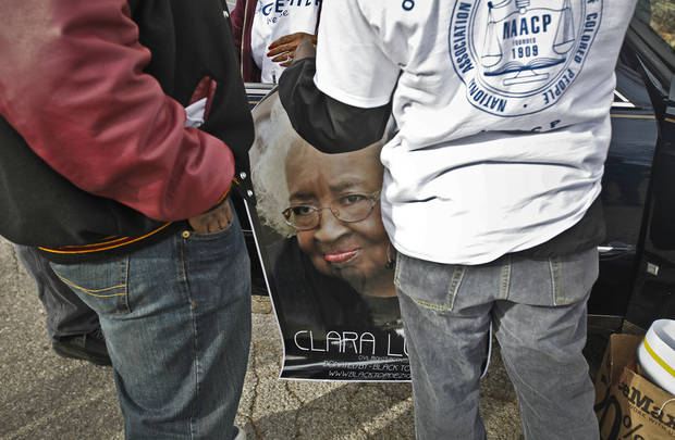 Members of the NAACP carry a poster of Clara Luper to hang on a car during Martin Luther King Jr. Day parade through downtown Oklahoma City on Monday, Jan. 16, 2012, in Oklahoma City, Okla. Photo by Chris Landsberger, The Oklahoman